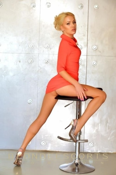blonde Christine upskirt pose