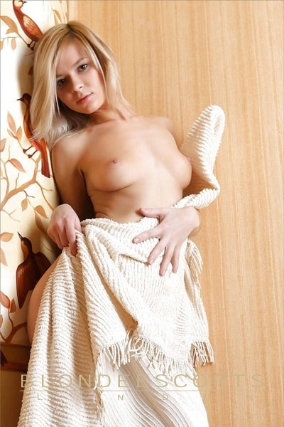 blonde escort Cindy innocent look